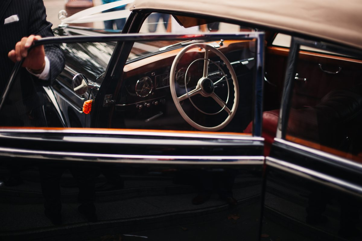 Canva - Black Classic Car Inside Well Lighted Room